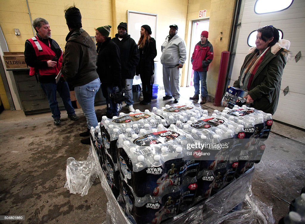 Flint residents line up to get bottled water, water testing kits, and water filters at a Flint Fire Station January 13, 2016 in Flint, Michigan. On Tuesday, Michigan Gov. Rick Snyder activated the National Guard to help the American Red Cross distribute water to Flint residents to help them deal with the lead contamination that is in the City of Flint's water supply.