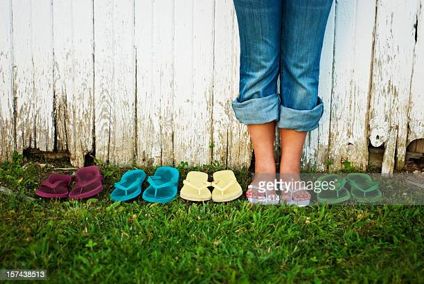 Flip Flop Summer, Teen Girl Standing with Many Sandals
