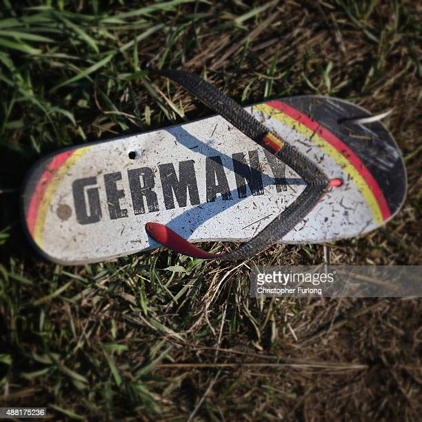 A flip flop that never made it to Germany lays on the ground as migrants discard items no longer wanted or needed when they cross the Hungarian...
