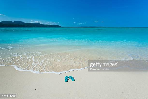 Flip flops on a paradise beach