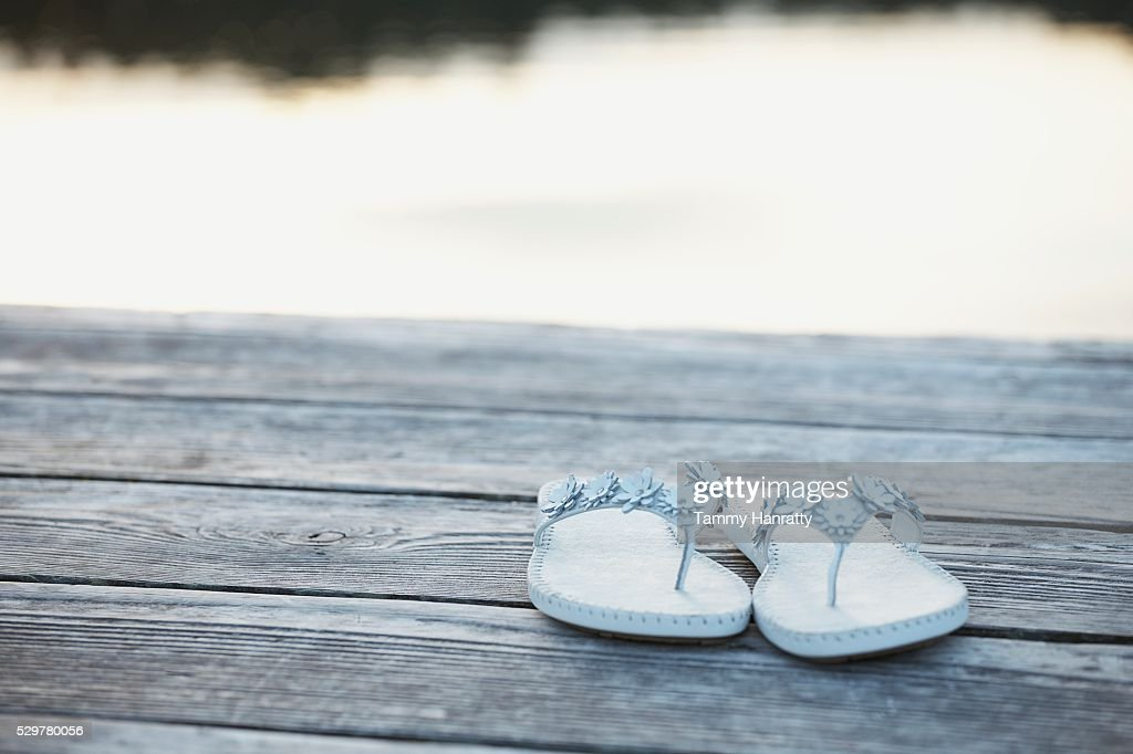 Flip flops on dock : Stock-Foto
