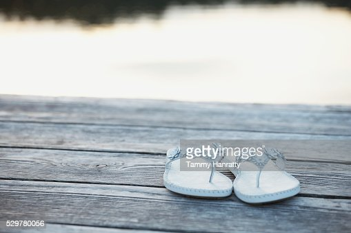 Flip flops on dock : Stock Photo
