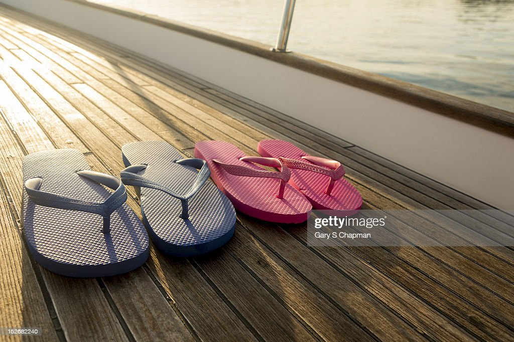 Flip flops on teak deck of 62 ft sailboat
