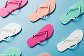 Overhead view of flip flops on the blue background. Horizontal