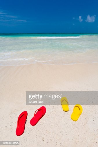 Flip flops on white sand beach, Mexico : Stock Photo