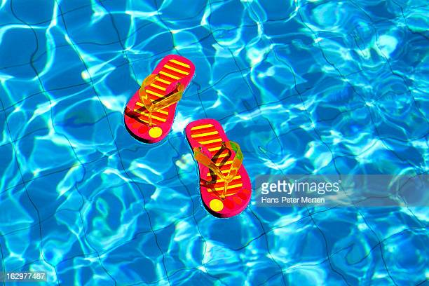 flip flops swimming in pool