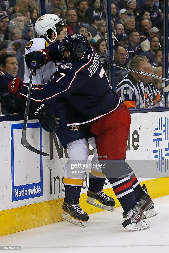 Flip Forseberg #9 of the Nashville Predators is checked into the boards by Jack Johnson #7 of the Columbus Blue Jackets while chasing after a loose puck during the third period on April 27, 2013 at Nationwide Arena in Columbus, Ohio. Columbus defeated Nashville 3-1.