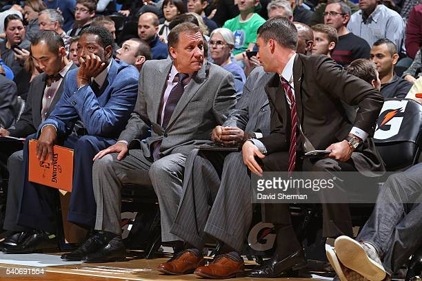 Flip Saunders and Ryan Saunders of the Minnesota Timberwolves talk on the bench during the game against the San Antonio Spurs on November 21 2014 at...