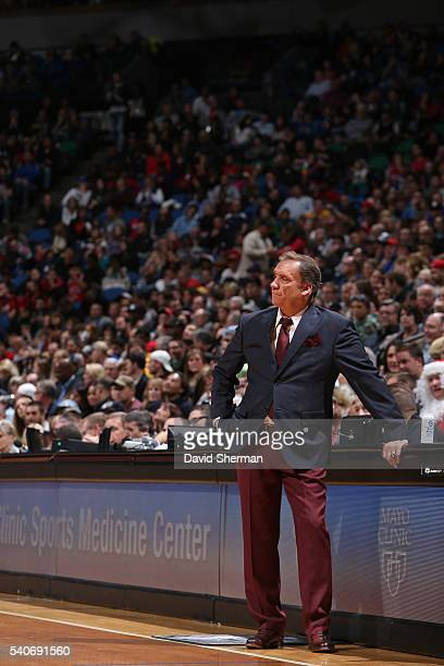 Flip Saunders of the Minnesota Timberwolves stands by the scorers table and coaches during the game against the Chicago Bulls on November 1 2014 at...