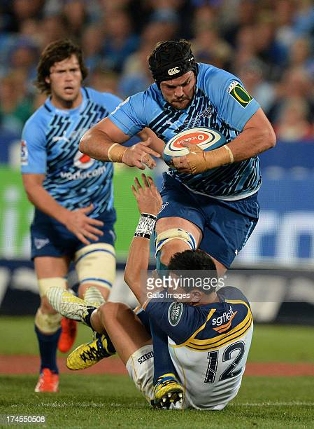 Flip van der Merwe of the Bulls is tackled by Christian Lealifano of Brumbies during the SupeRugby semi final match between Vodacom Bulls and...