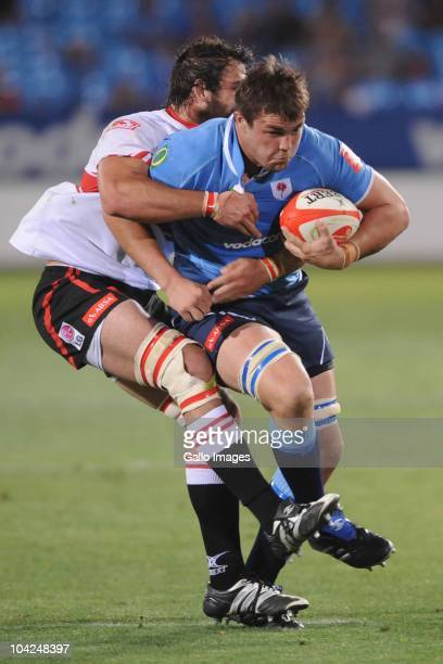 Flip van der Merwe of the Bulls is tackled by Joshua Strauss of the Lions during the Absa Currie Cup match between Vodacom Blue Bulls and Xerox Lions...