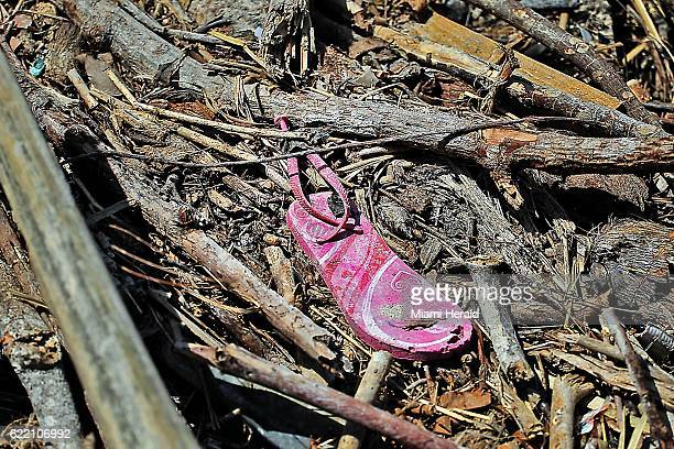 A flipflop sits in the debris along the storm battered beach in Port Salut Haiti on October 11 2016