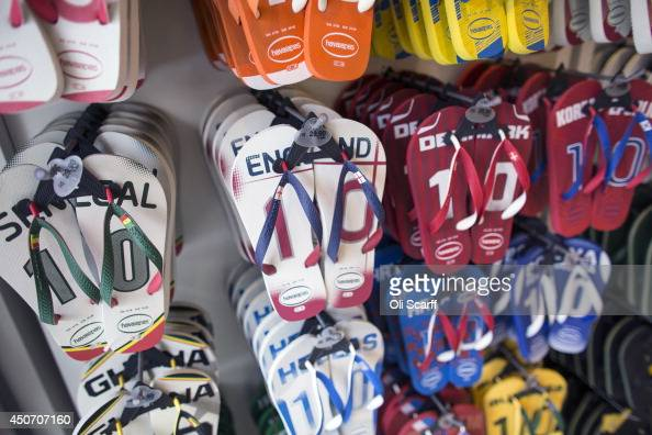Flipflops branded with various national teams playing in the FIFA World Cup are displayed for sale on June 16 2014 in Manaus Brazil Group D teams...
