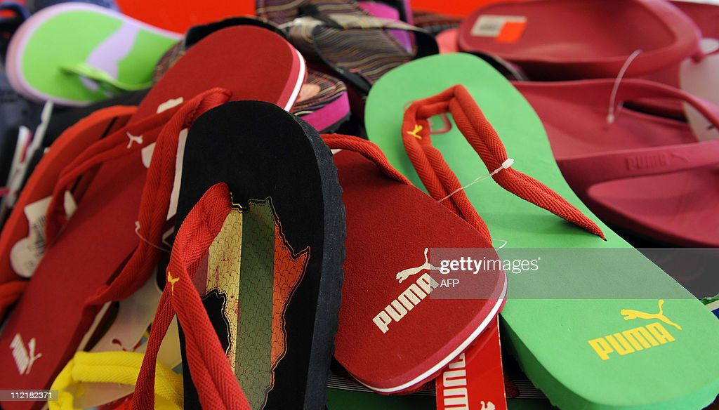 Flip-flops of German sportswear maker Puma are on display at the company's headquarters in Herzogenaurach, southern Germany, where the company holds its annual shareholders' meeting on April 14, 2011. Puma said that Franz Koch would become its next chief executive as part of the firm's transformation into a European corporation (SE). AFP PHOTO / CHRISTOF STACHE