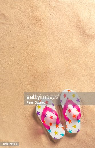 Flip-flops on beach with copy space