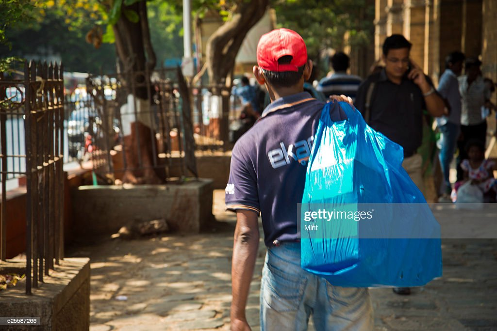 A Flipkart's delivery guy delivering packages near Churchgate on May 21, 2015 in Mumbai, India.