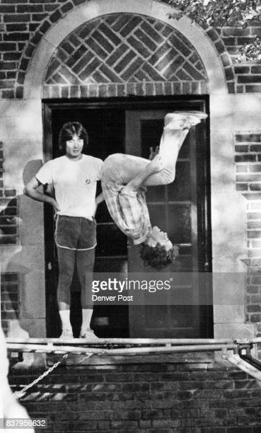 Flipped Out Wednesday's weather was just right for out on a trampoline for these two Denver University students outside the Sigma Alpha Epsilon...