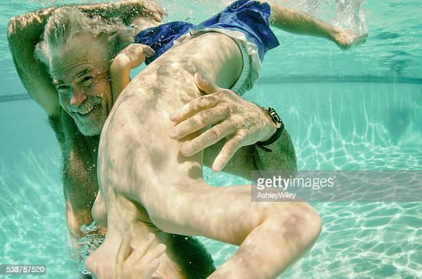 Flipping for Grandpa underwater in summer