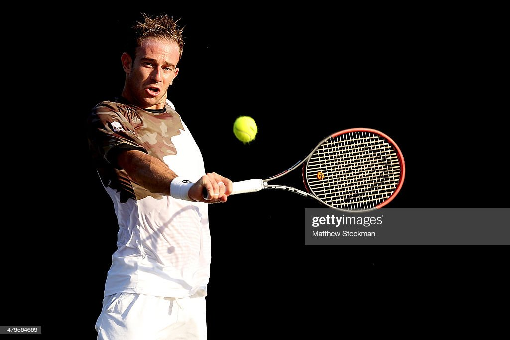 Flippo Volandri of Italy returns a shot to Jiri Vesely of Czech Republic during the Sony Open at the Crandon Park Tennis Center on March 19, 2014 in Key Biscayne, Florida.
