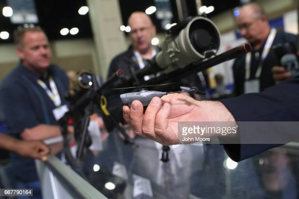 Flir Systems salesman displays a nano drone at the Border Security Expo on April 12 2017 at the Henry B Gonzalez Convention Center in San Antonio...