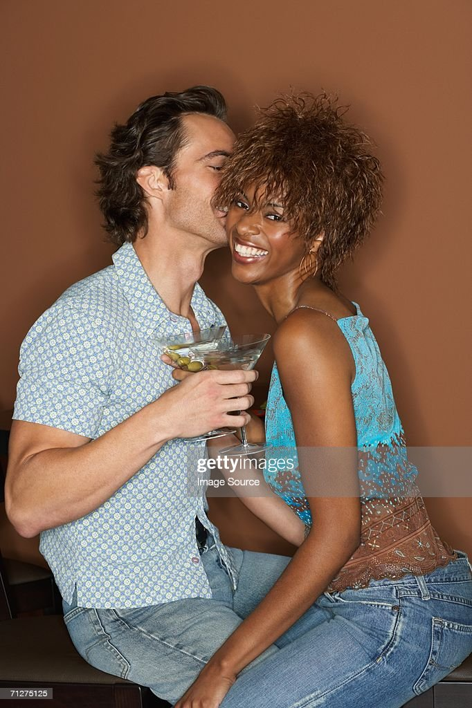 Flirtatious couple with cocktails : Stock Photo