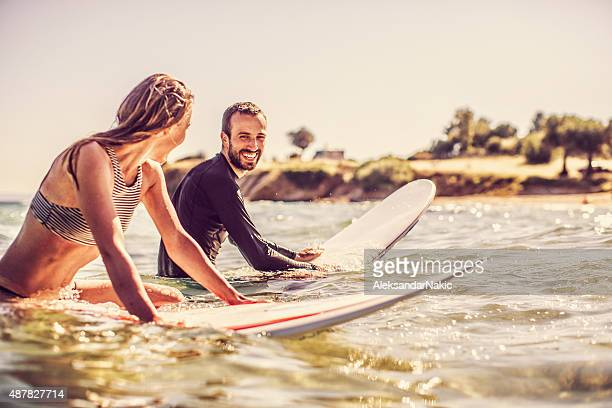 Flirting on their surfboards