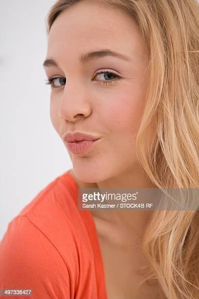 Flirty blond young woman, portrait