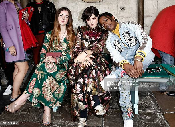 Flo Morrissey Soko and ASAP Rocky attend the Gucci Cruise 2017 fashion show at the Cloisters of Westminster Abbey on June 2 2016 in London England