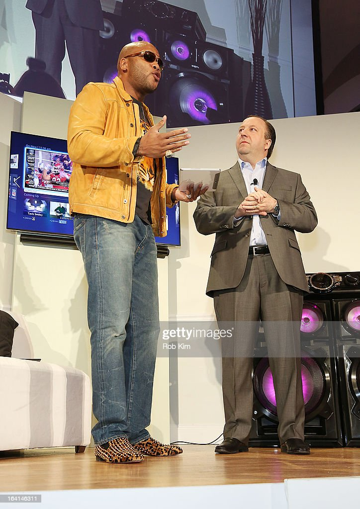 <a gi-track='captionPersonalityLinkClicked' href=/galleries/search?phrase=Flo+Rida&family=editorial&specificpeople=4456012 ng-click='$event.stopPropagation()'>Flo Rida</a> and Joe Stinziano, Executive Vice President Samsung Electronics America attend the launch of Samsung's 2013 Television line at Museum Of American Finance on March 20, 2013 in New York City.
