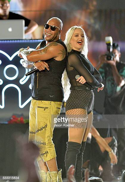 Flo Rida and Macy Kate perform on stage during 2016 iHeartRadio Summer Pool Party at Fountainbleau Miami Beach on May 21 2016 in Miami Beach Florida