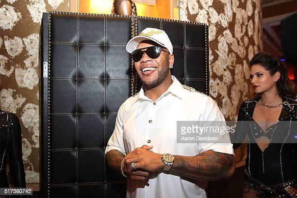 Flo Rida donates memorabilia to Hard Rock Collection at Seminole Hard Rock Hotel Casino Hard Rock Cafe Hollywood on March 24 2016 in Hollywood Florida