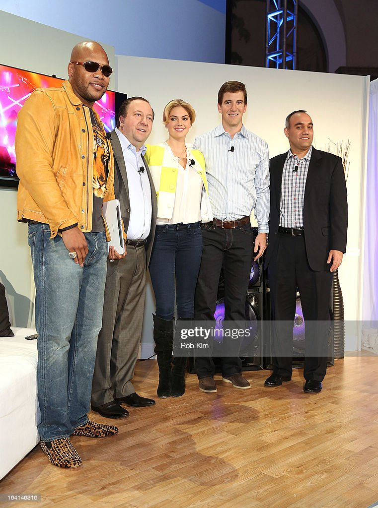 Flo Rida, Joe Stinziano, Kate Upton, Eli Manning and a Samsung representative attend the launch of Samsung's 2013 Television line at Museum Of American Finance on March 20, 2013 in New York City.