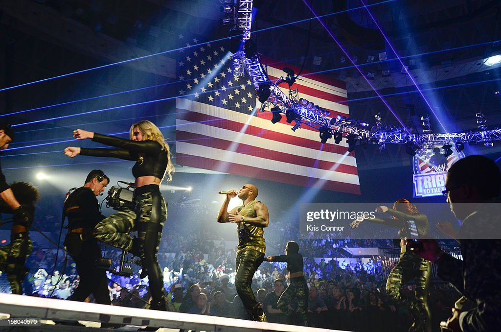 <a gi-track='captionPersonalityLinkClicked' href=/galleries/search?phrase=Flo+Rida&family=editorial&specificpeople=4456012 ng-click='$event.stopPropagation()'>Flo Rida</a> performs during the 10th anniversary of WWE Tribute to the Troops at Norfolk Scope Arena on December 9, 2012 in Norfolk, Virginia.