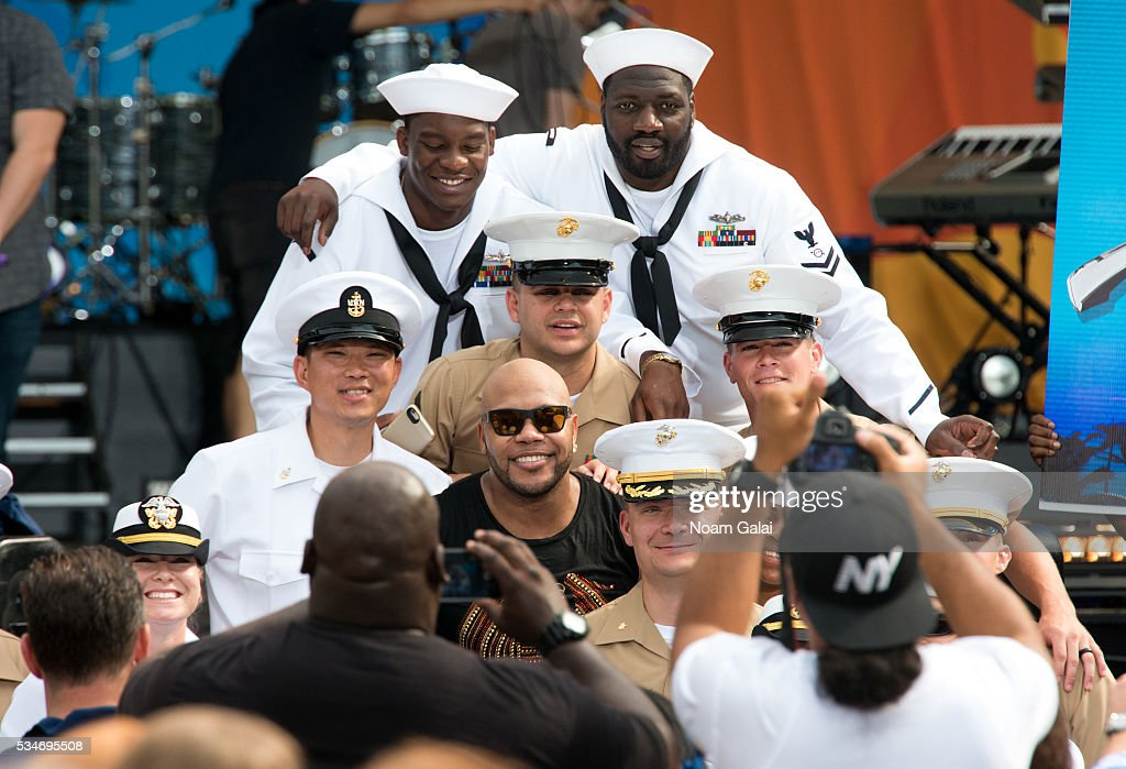 <a gi-track='captionPersonalityLinkClicked' href=/galleries/search?phrase=Flo+Rida&family=editorial&specificpeople=4456012 ng-click='$event.stopPropagation()'>Flo Rida</a> poses with sailors during ABC's 'Good Morning America' 2016 summer concert series at SummerStage at Rumsey Playfield, Central Park on May 27, 2016 in New York City.