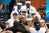 Flo Rida poses with sailors during ABC's 'Good Morning America' 2016 summer concert series at SummerStage at Rumsey Playfield Central Park on May 27...
