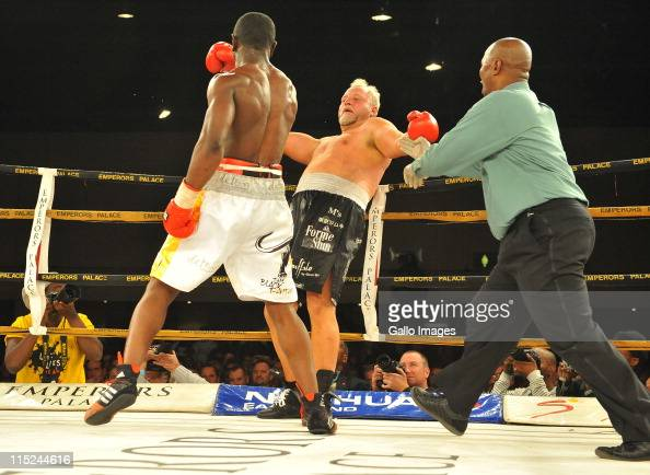 Flo Simba punches Francois Botha during their Heavyweight Bout at Emperors Palace on June 4 2011 in Johannesburg South Africa