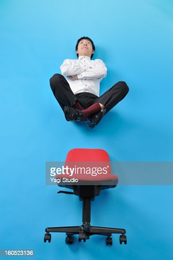 Float a man on a chair : Stock Photo