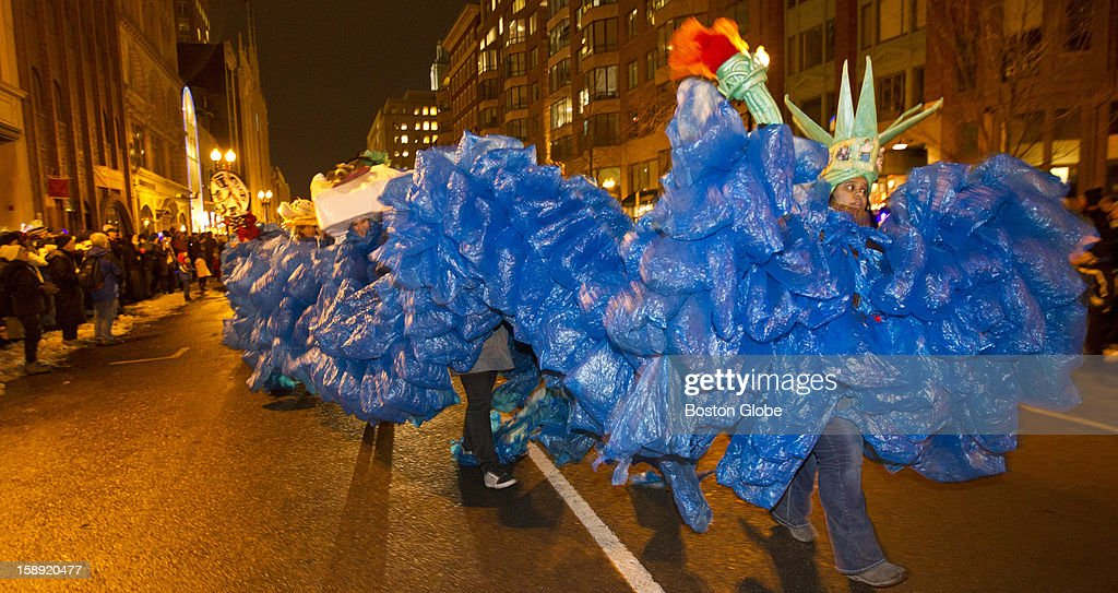 A float about global warming makes its way down Boylston Street during the parade at First Night, Boston's New Year's Eve celebration, on Monday, Dec. 31, 2012.