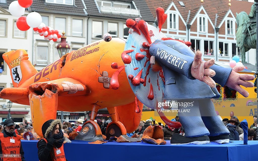 A float featuring Berlin mayor Klaus Wowereit makes its way through the streets of Duesseldorf during the traditional Rose Monday parade on February 11, 2013. Carnival goers mainly in the Rhine region traditionally celebrate the highlight procession on Rosenmontag (Rose Monday). The season ends with Ash Wednesday on February 13, 2013.