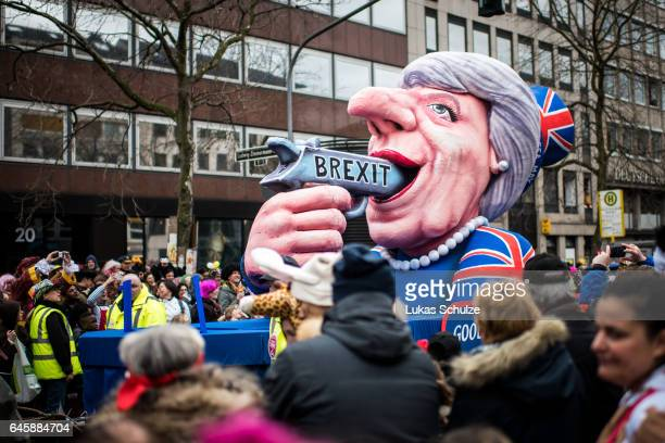 A float featuring British Premier Theresa May drives in the annual Rose Monday parade on February 27 2017 in Dusseldorf Germany Political satire is a...