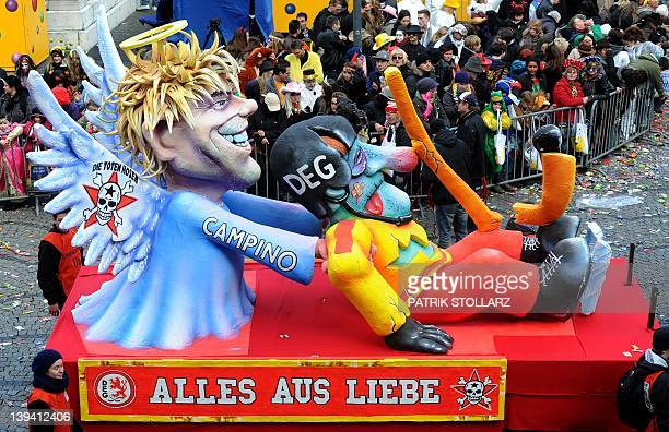 A float featuring Campino the singer of german rock band Toten Hosen rescuing Duesseldorf´s hockey club DEG makes its way through the streets of...