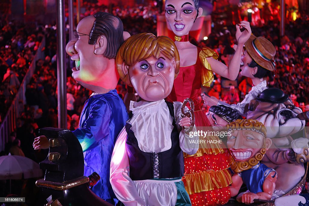 A float featuring French President Francois Hollande and German Chancellor Angela Merkel parades on February 16, 2013 during carnival in the southeastern French city of Nice. The carnival, which ends on March 6, celebrates the King of the Five Continents for its 140th anniversary.