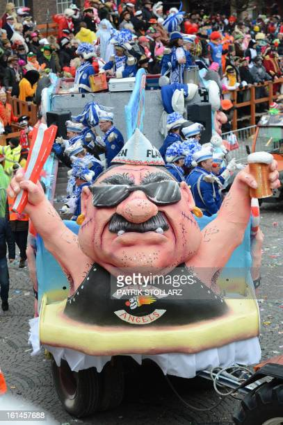 A float featuring motorcycle club Hells Angels makes its way through the streets of Duesseldorf during the traditional Rose Monday parade on February...
