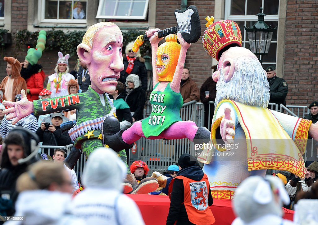 A float featuring Russian president Vladimir Putin and a member of the imprisoned Russian punk band Pussy Riot makes its way through the streets of Duesseldorf during the traditional Rose Monday parade on February 11, 2013. Carnival goers mainly in the Rhine region traditionally celebrate the highlight procession on Rosenmontag (Rose Monday). The season ends with Ash Wednesday on February 13, 2013.