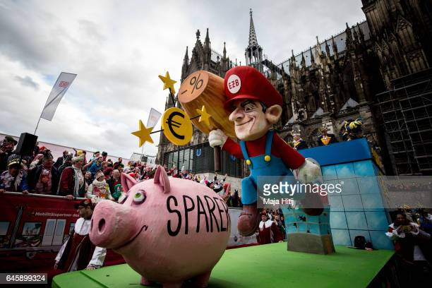 A float featuring Super Mario drives in the annual Rose Monday parade next to the Cathedral on February 27 2017 in Cologne Germany Political satire...
