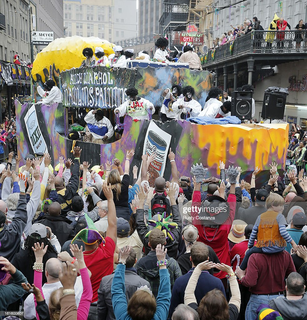 A float in the Krewe of Zulu parade turns on to Canal Street to large crowds with out outstretched arms on Mardi Gras Day. Fat Tuesday, the traditional celebration on the day before Ash Wednesday and the begining of Lent, is marked in New Orleans with parades and marches through many neighborhoods in the city.