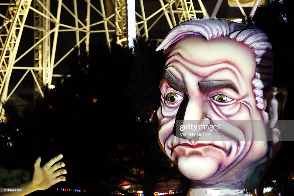 A float named 'The trap' depicting French former IMF head and politician Dominique Strauss-Kahn parades during the Nice Carnival on February 13, 2016 in Nice, southeastern France. The carnival starts February 13 until 28 February 2016, and this year's theme celebrates the 'King of Medias' / AFP / VALERY HACHE