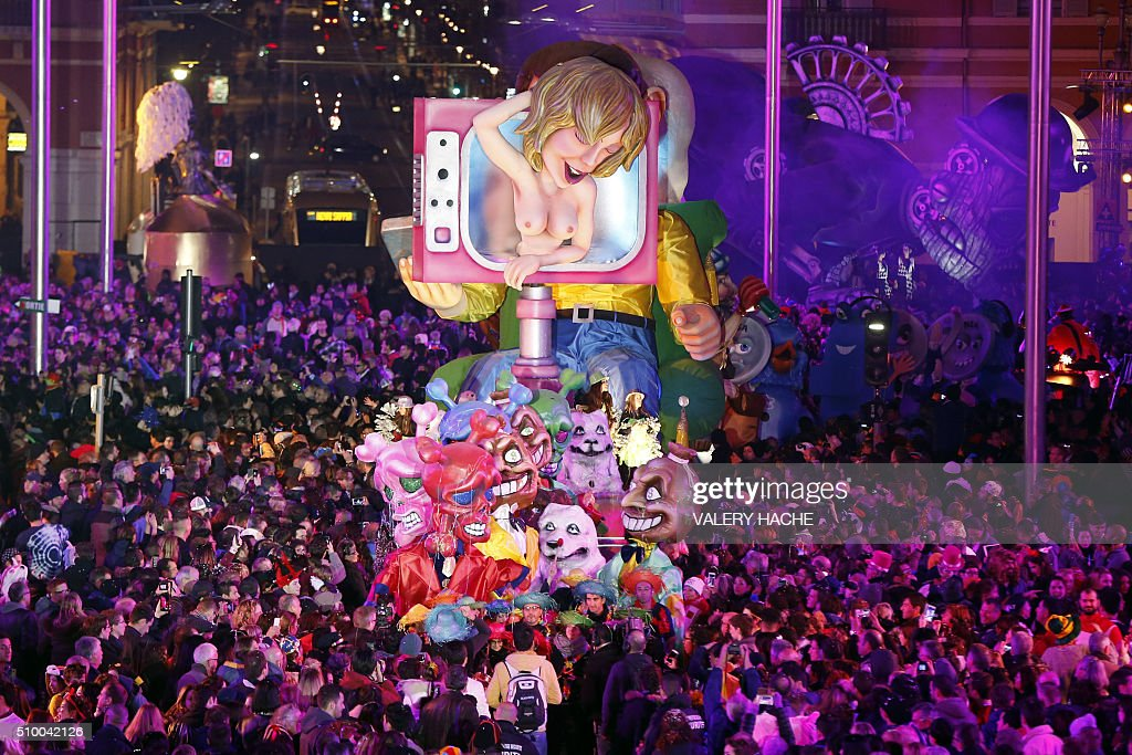 A float named 'Weapon of mass distraction' parades during the Nice Carnival on February 13, 2016 in Nice, southeastern France. The carnival starts February 13 until 28 February 2016, and this year's theme celebrates the 'King of Medias' / AFP / VALERY HACHE