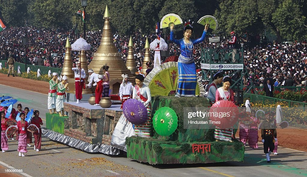 A float representing the Indian state of Tripura ( Sangrai Festival of the Mog Community of Tripura ) rolls down the ceremonial boulevard Rajpath during the 64th Republic Day parade celebration on January 26, 2013 in New Delhi, India. India marked its Republic Day with celebrations held under heavy security, especially in New Delhi where large areas were sealed off for an annual parade of military hardware.
