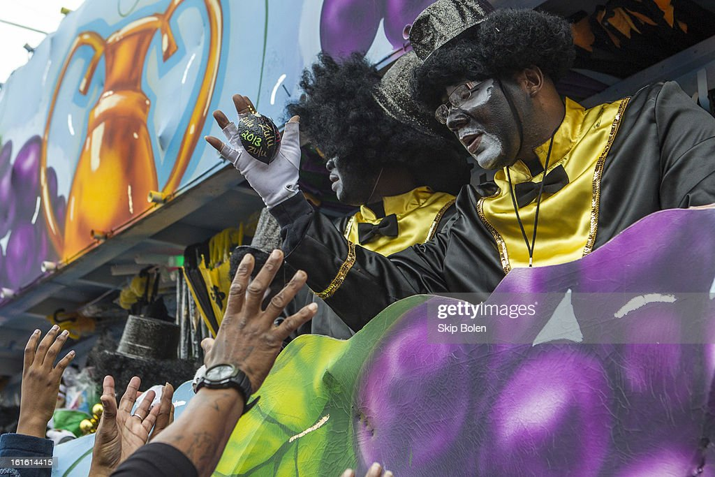 A float rider in the Zulu Social Aid & Pleasure Club's 'Zulu Parade' hands beads to fans and parade-watchers on the morning of Mardi Gras on February 12, 2013 in New Orleans, Louisiana.